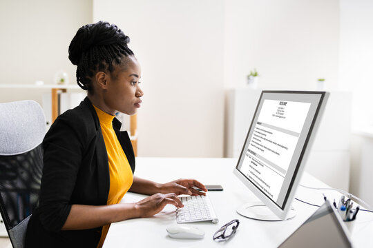 African Business Manager Reading Resume