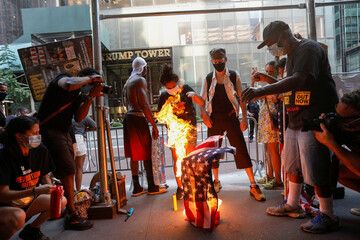 Black Lives Matter Fourth of July U.S. flag burning protest in Manhattan, New York City