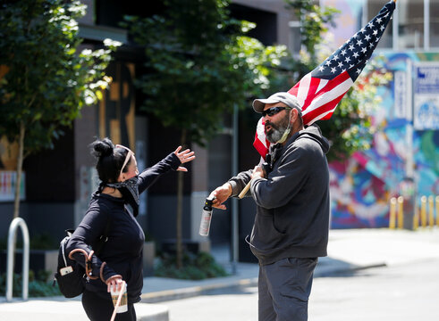 Trump supporters and people with American flags march through the former CHOP area during the Fourth of July holiday in Seattle