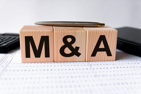 cubes with the word M&A on them. Care concept.