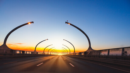 modern highway toll road at sunset