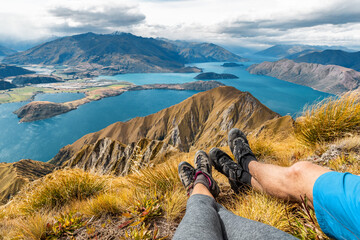 Wanderlust adventure and hiking travel vacation concept with hikers hiking boots close up. Hiker...