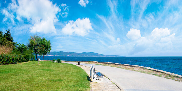 bench on the sea embankment. summer vacation and beach relax concept. nessebar beautiful travel destination of bulgaria. sunny weather. panoramic view