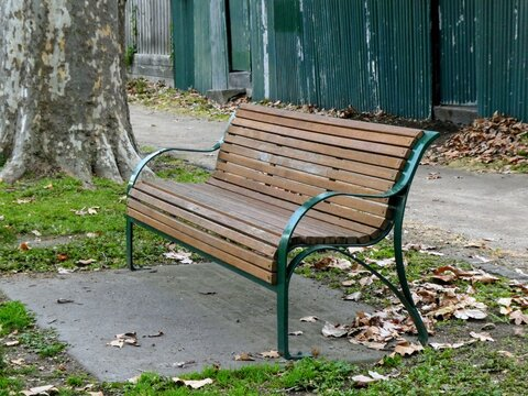 Wood and metal public park bench in an urban setting
