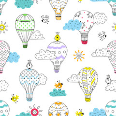 Cartoon seamless pattern with hot air balloons and birds in the sky on white background