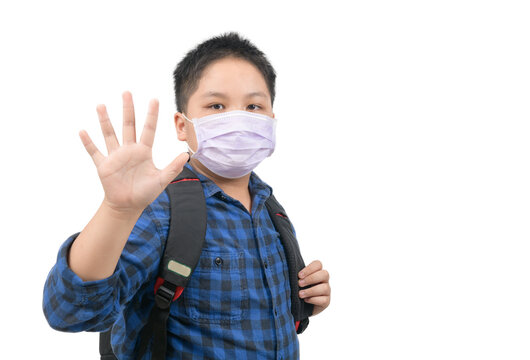 Asian boy student wear mask and waving goodbye before go to school