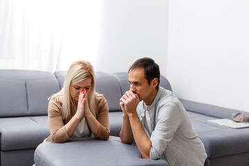 woman and man pray at home