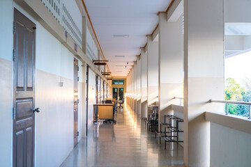 Fototapeta High School hallway corridor in College or university empty hall at classroom, no people student while closed quarantine in situation of Covid-19 disease outbreak result in inability organize learning obraz