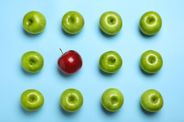 Fototapete - Tasty green apples and red one on light blue background, flat lay