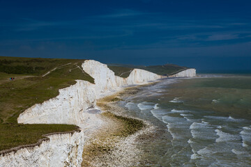 Severn Sisters white cliffs over the ocean, Cuckmere, in the South Downs National Park, East Sussex, UK