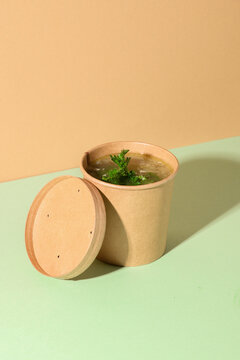 Healthy chicken broth on brown paper. Vertical format. Creative minimal style.