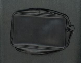 black leatherette texture bag