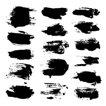 Black abstract brush strokes isolated on a white background