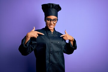 Young african american chef girl wearing cooker uniform and hat over purple background looking confident with smile on face, pointing oneself with fingers proud and happy.