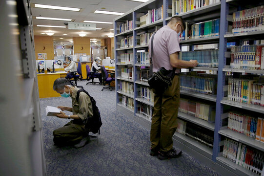People read books at Hong Kong Central Library after democracy activists' books were taken down due to national security law in Hong Kong
