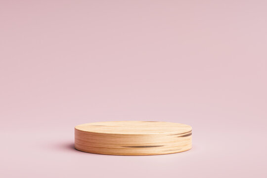 Wooden product display or showcase pedestal on pink background with cylinder stand. Pink studio podium or platform product template. 3D rendering.
