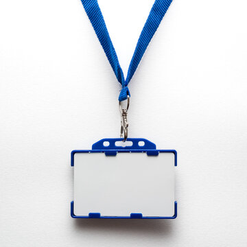 Blank name tag or identification badge on blue strap. White background