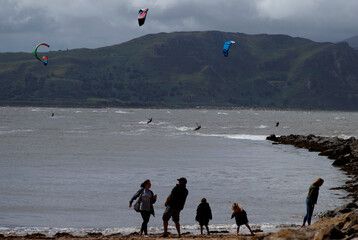 Kite surfers are seen in the sea off the West Shore Beach as lockdown conditions in Wales ease following the outbreak of the coronavirus disease (COVID-19), in Llandudno, Britain