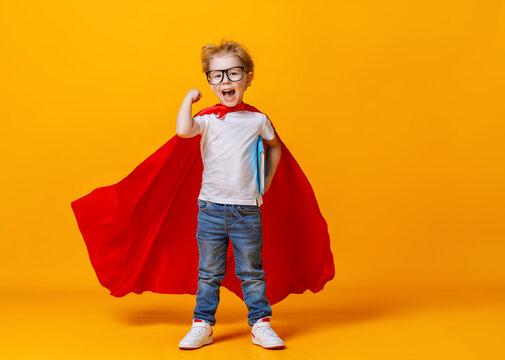 Happy smart superhero showing bicep.