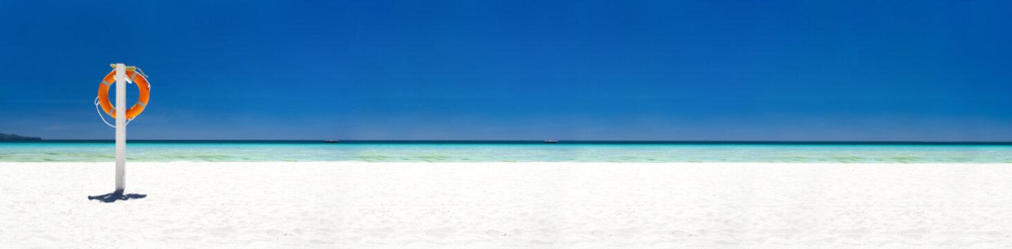 Lifebuoy ring on tropical beach