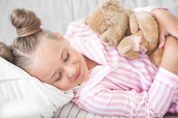 Cute sleepy girl in the bed