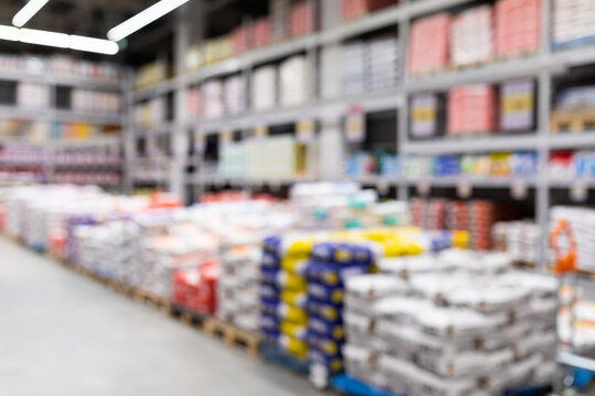 blurred background of a hardware store with bags of cement