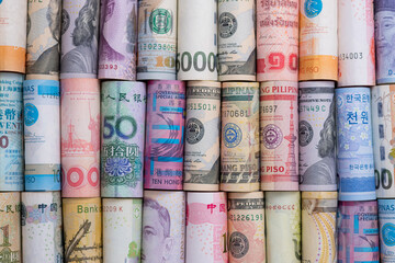 Closeup rolled of variety banknote and multi currency around the world. Exchange rate and Forex investment concept.-Image.