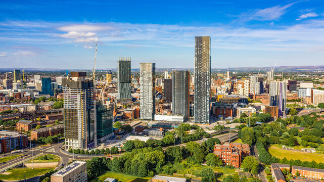 Aerial shot of Manchester UK on a beautiful summer day during pandemic lock-down
