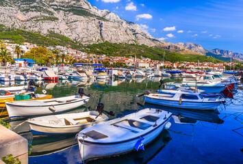 Croatia summer holidays - Famous Adriatic coast - Makarska riviera in Dalmatia. Charming marine with fishing boats.