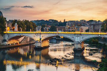 Tuinposter Oude gebouw Tiber river with illuminated bridge in Rome evening at sunset, Italy.