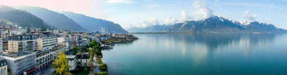 Foto auf Acrylglas Blau Jeans Panoramic view of the Montreux, Switzerland, lake Lec Leman and mountains in the background.