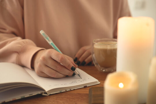 Woman writes in open notebook. Diary Concept for Psychological Health.