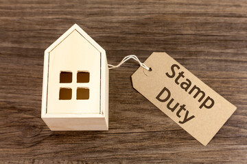 Photo sur Toile Nature Wooden house with label attached which reads 'Stamp Duty'