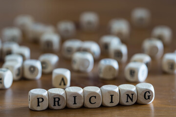pricing written with wooden cubes