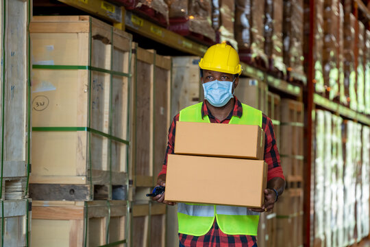 Warehouse workers wearing protective mask.