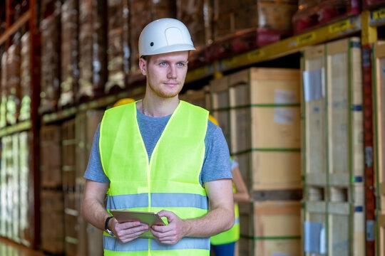 Technician works in merchandise trade in logistics.