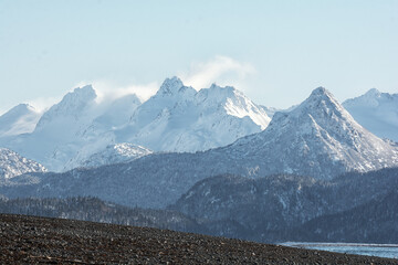 China Poot in the fore ground of wintery shot of the Kenai Peninsula Mountain range.psd