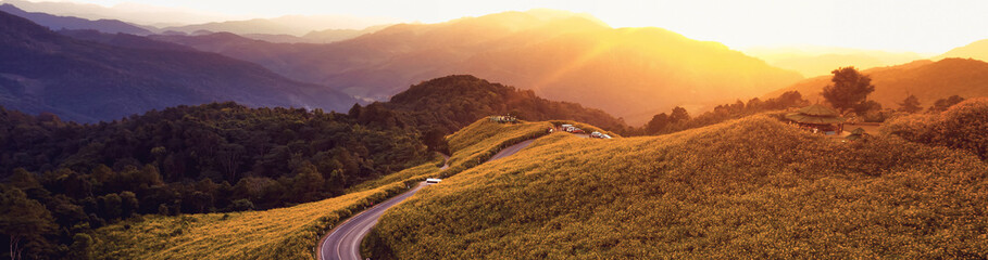 Panorama Beautiful landscape of Mountain in Twilight time nature flower Tung Bua Tong Mexican sunflower field ,Mae Hong Son,Thailand .