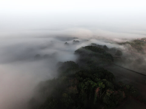 High Angle View Of Fog Covered Mountain Against Sky