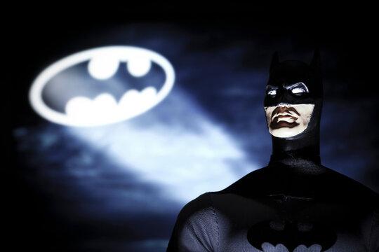 NEW YORK USA - OCT 27 2018:  Portrait of Batman with the Bat Signal, Gotham City - DC Comics - Mego action figure