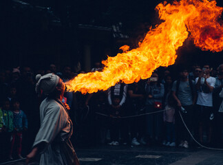 Obraz Fire Breather Blowing Fire While Standing Outdoors At Night - fototapety do salonu