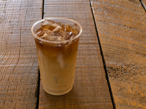 Nitro Cold Brew Coffee In A Clear Cup On A Wood Background With Copy Space.