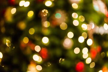 Fotomurales - Defocused Image Of Illuminated Christmas Tree