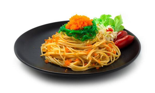 Spaghetti Ebiko and Seaweed salad decorate Leek flower shape and vegetable. Japanese combination italian Food