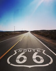 Tuinposter Route 66 Route 66 Written On Road Against Blue Sky