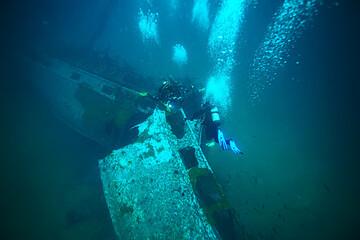 shipwreck diving landscape under water, old ship at the bottom, treasure hunt