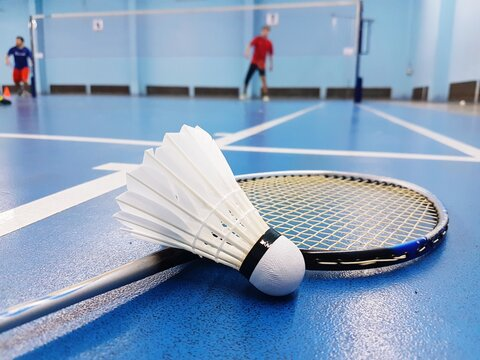 Close-up Of Badminton Racket And Shuttlecock On Court