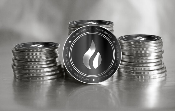 Huobi Token (HT) digital crypto currency. Stack of black and silver coins. Cyber money.