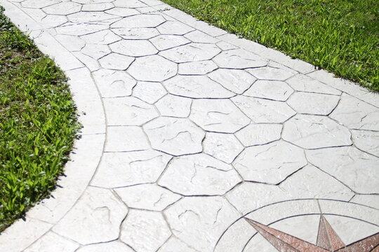 Printed grey concrete path compass