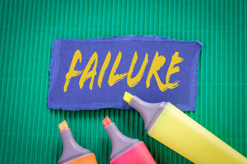 FAILURE. Business concept. Text on torn, colored paper
